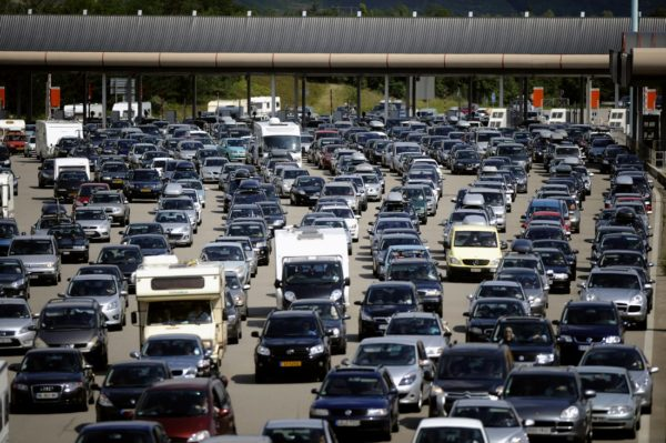 """Vehicles leave after queuing up at the """""""